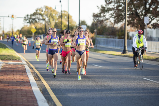 Brianne Nelson leads the pack that chased after Molly Huddle. Nelson finished fifth. Photo: Dustin Whitlow/ D. Whit Photography