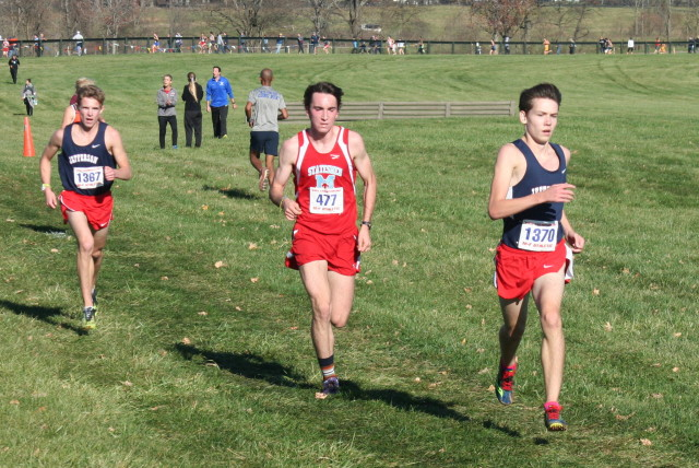 Thomas Jefferson's Dylan Klapper and Nathan Riopelle flank George Marshall's Alex Haight during the 5A boys race. Photo: Charlie Ban
