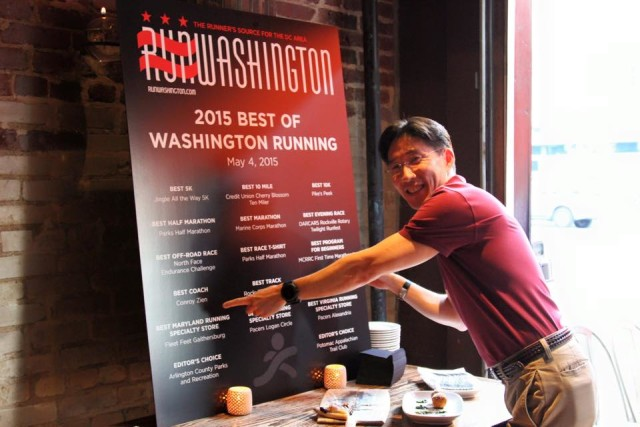 Conroy Zien, 2015's best coach, points to his name on the list of winners at last year's Best of Washington Running party. Photo: Steve Laico