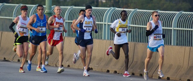 Ian Hankins leads a group over the Key Bridge during the 2010 Marine Corps Marathon. Photo; Cheryl Young