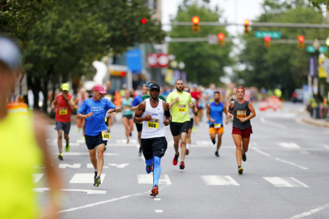 Ashburn's John Johnson storms down Clarendon Boulevard on his way to a 48:10 10k. Photo: Swim Bike Run Photography