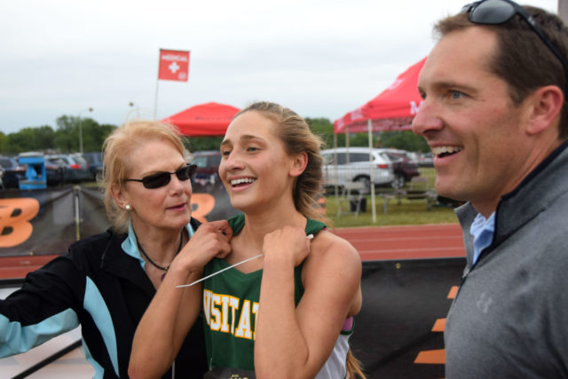 Georgetown Visitation freshman Megan Lynch celebrates her DCXC Invitational race win with her parents. Photo: Charlie Ban