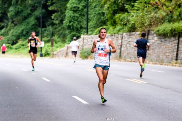 Bethesda native Daniel Samet leads the way in his half marathon debut at the Navy-Air Force Half Sept. 18. Photo: Dustin Whitlow/DWhit Photography