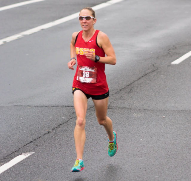 Christine Taranto nearing the finish line of the 2015 Marine Corps Marathon. Photo by Cheryl Young