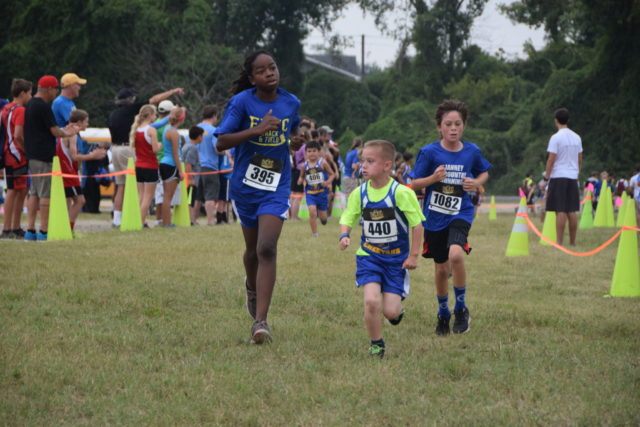 Jalen Bunch, Cort Merritt and Henry Reid race during the DCXC Invitational. Photo: Charlie Ban