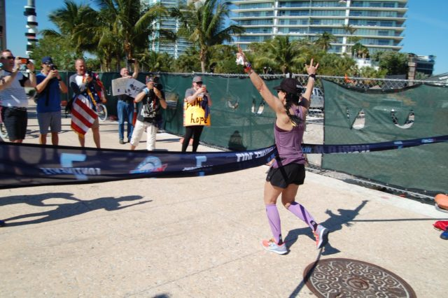 Telford finishes the second marathon, in Miami.