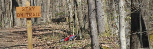 John Kelly sleeping within view of the Barkley Marathons camp in 2016. Photo: