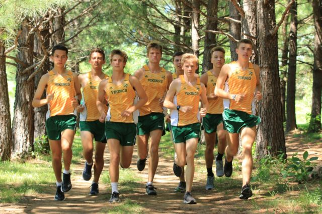 The Loundoun Valley top eight run their home course at Franklin Park in Purcelleville. From left: Peter Morris, Jacob Windle, Chase Dawson, Noah Hunter, Kevin Carlson, Conor Wells, Colton Bogucki, and Sam Affolder. RunWashington photo by Ed Lull.
