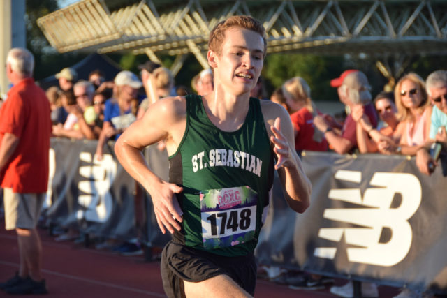 Caleb McCurdy closes in on the finish line during the senior boys' race. Photo: Charlie Ban