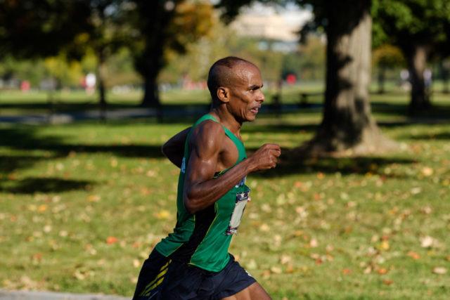 Desto Morkama chases Kieran O'Connor in the 17th mile of the 2017 Marine Corps Marathon. Photo: Dustin Whitlow