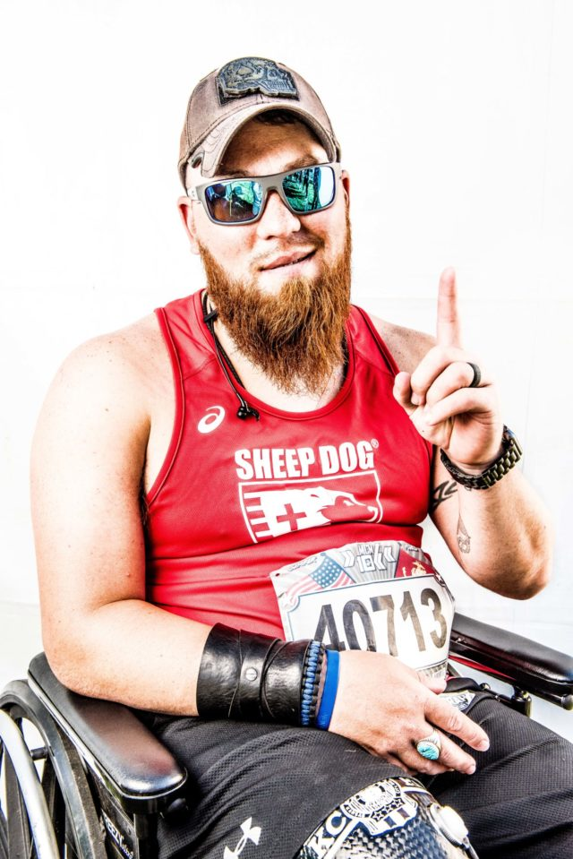 Photo By Doug Stroud Nate Harrison of Kansas City, MO, retired Marine Corps serving in Fallujah, Iraq, competed in the 2017 Marine Corps Marathon 10K finishing with a time of 2:12:24. Harrison who started off on his legs traded off between pushing himself, others pushing and then finishing the race on his legs. He has set a goal of returning to run the full marathon without the assistance of his chair or others help.