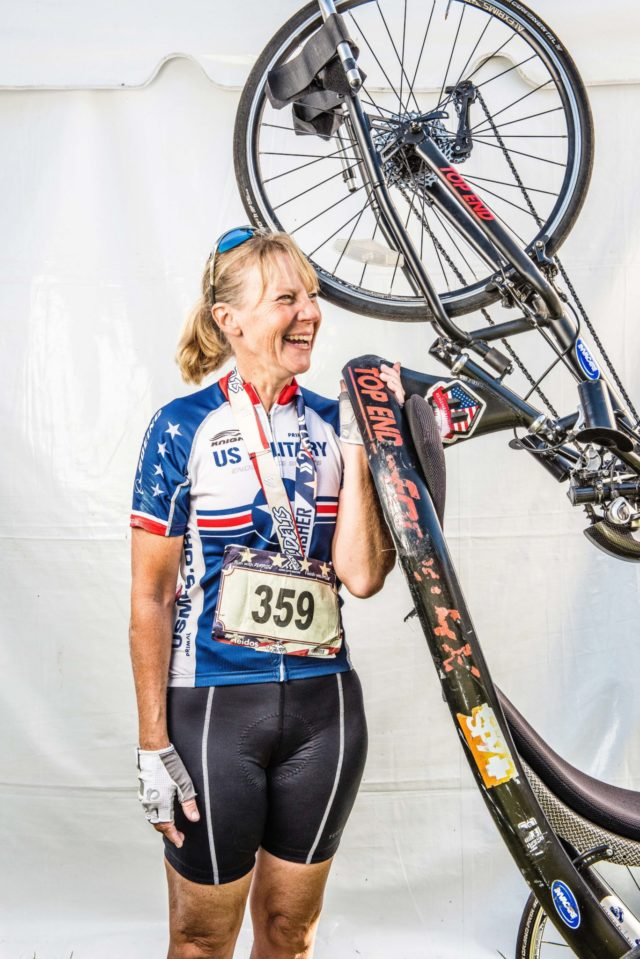 "Photo By Doug Stroud Sue Davisan Air Force veteran of Greenville, SC took first place in the Womens Division for hand cyclists with a time of 1:51:37 in the 2017 Marine Corps Marathon. Davis who typically rides a bicycle competed in her first hand cyclist event after an injury and surgery earlier in the spring, "" I got a couple of buddies, Eddie and Joe I ride with and a couple great mechanics that help keep it [sic] hand cycle running, it was broken when I got it and I came up today to just to celebrate with everybody. The course is challenging with all the turns, it is a beautiful course, it was awesome""!"